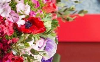 bouquet of flowers by red door